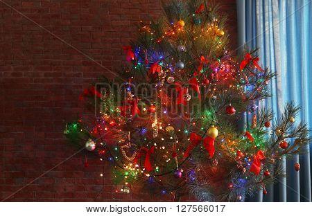 Christmas tree on brick background