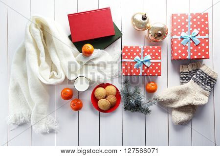 Christmas composition with gift boxes, cookies and decorations on a white table