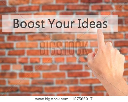 Boost Your Ideas - Hand Pressing A Button On Blurred Background Concept On Visual Screen.