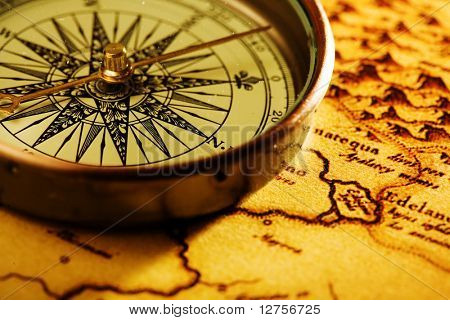 Close up view of compass and old map