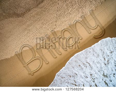 Brittany written on the beach