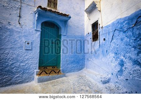 Detail of a door and window in the town of Chefchaouen in Morocco.