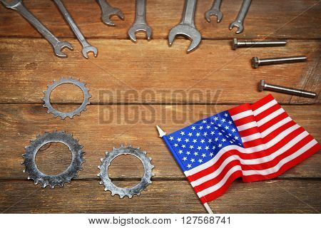 Different kinds of wrenches and cogwheels on a wooden background. Labor day concept.
