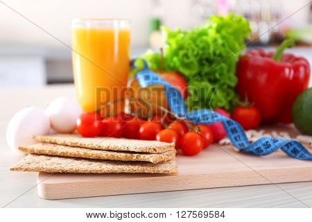 Set of fresh fruits and vegetables on wooden table closeup