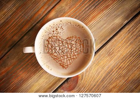 Cup of coffee with heart drawing, top view