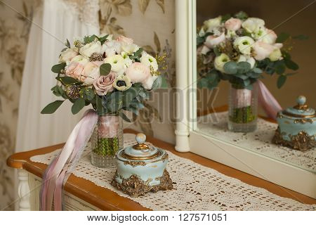 Wedding decoration. Vintage background, accessories. Wedding bouquet. Morning bride. Wedding rings.