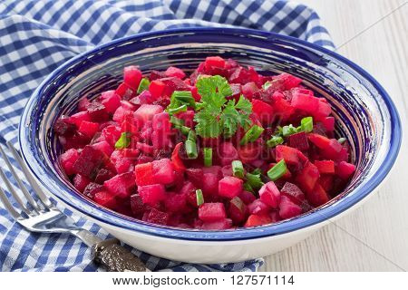 Beetroot salad vinaigrette with beetroot carrot potato cucumber and green leek