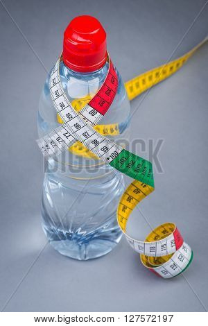 Bottle Of Fresh Still Water With Measuring Tape
