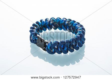 braided bracelet on white background.  synthetic cord