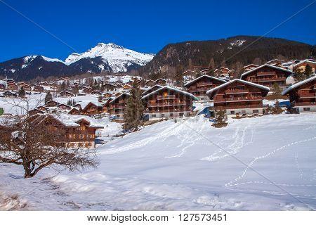 WENGEN SWITZERLAND March 1 2013 - Snowy mountain chalet in Swiss Alps