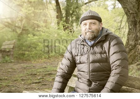 An image of a bearded man in winter jacket
