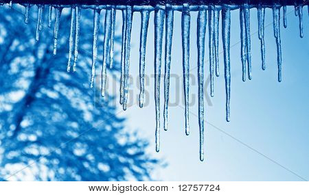 Close up view of the some icicles with a blue duo-tone effect