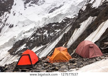 Mountain Climbers Camp on Rock Moraine of Glacier High Altitude Severe Landscape
