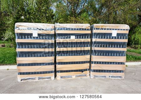 Wine bottles deposit with big boxes at a winery