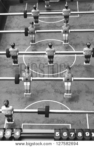 Vintage foosball, black and white photo, retro style