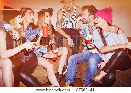 Happy swag friends enjoying gathering in night club