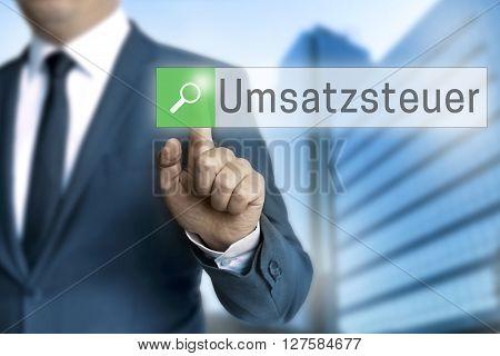 Umsatzsteuer (in german VAT) browser operated by businessman background.