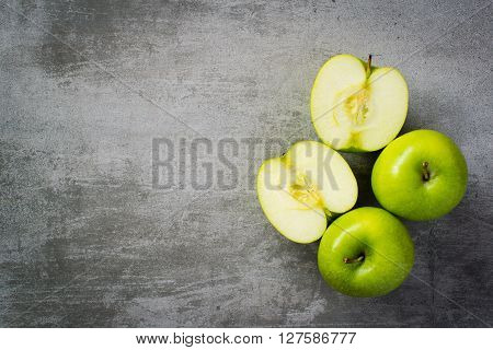 Green Apples On Concrete Background
