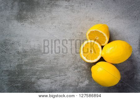 Lemons On Concrete Background