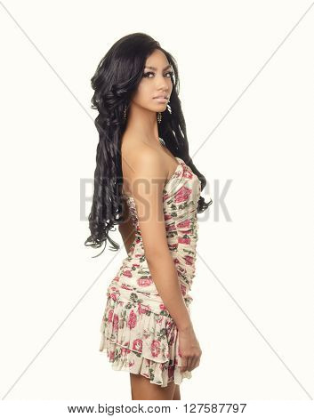 Beautiful young woman with long dark hairwearing pretty summer dress