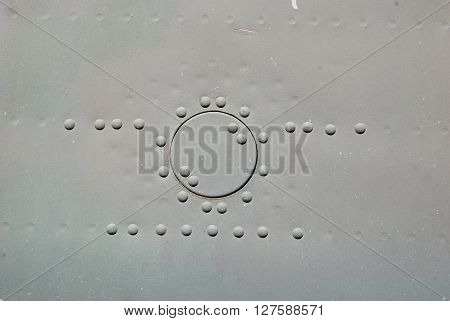 old iron plate with rivets hatch gray paint