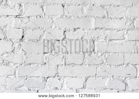 Vintage brick wall background painted in white.