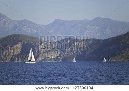 Yachting in Turkey - view of yachts and mountains from the sea