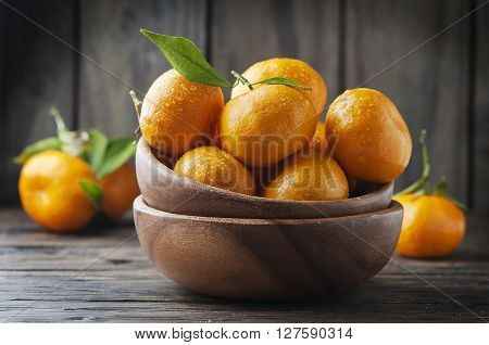 Sweet Fresh Mandarin On The Wooden Table