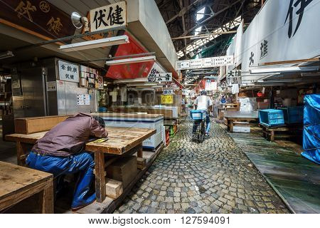 TOKYO, JAPAN - JUNE 2: Unidentified worker rests after working in the famous tokyo fish market on June 2, 2015 in Japan