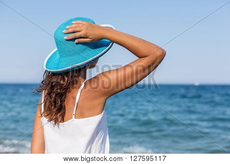 Woman relaxing at the seaside.