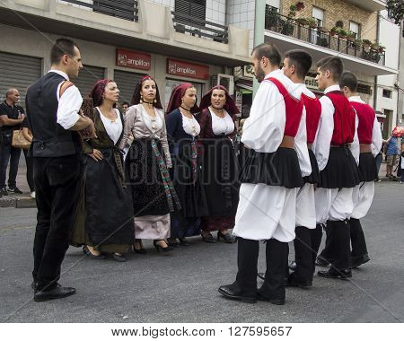 QUARTU S.E., ITALY - September 21, 2014: Parade of Sardinian costumes and floats for the grape festival in honor of the celebration of St. Helena. folk group performing during the event