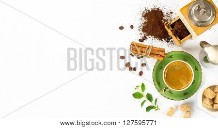 Coffee composition on a white background. Espresso, coffee grinder, milk, sugar. Space for text
