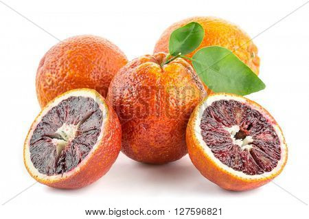 red blood oranges with cut and green leaves isolated on white background.