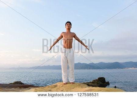 Portrait of full body handsome man doing yoga exercise in outdoors