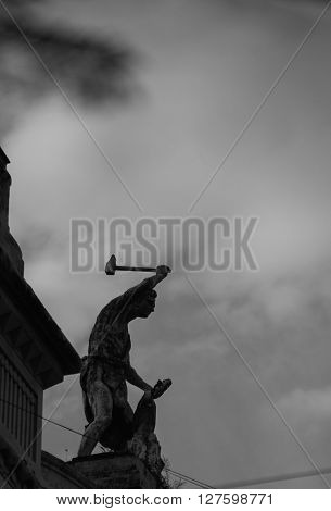 Statue swinging a hammer in buenos aires ** Note: Soft Focus at 100%, best at smaller sizes