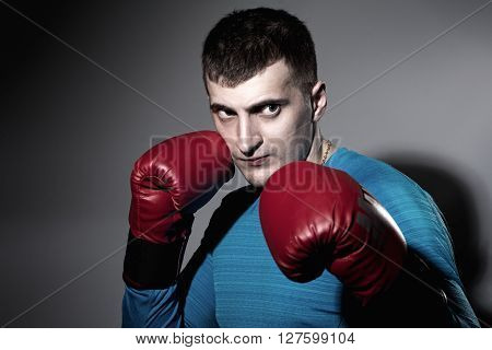 Boxer in red gloves on a black background