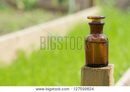 little brown bottle and grass