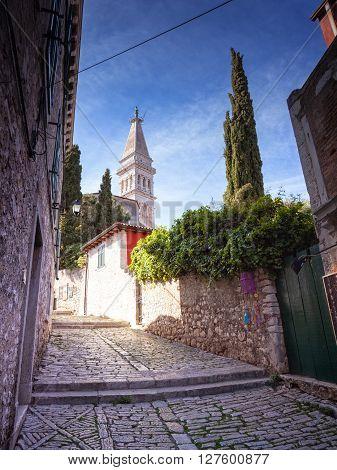 Alley of Rovinj Saint Euphemia's basilica in the background
