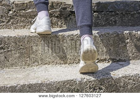 Young girl walking up on the concrete stairs ** Note: Soft Focus at 100%, best at smaller sizes