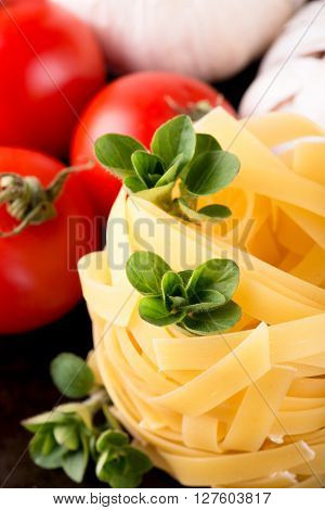 Three Stigs Of Oregano On Portion Of Fettuccine Pasta