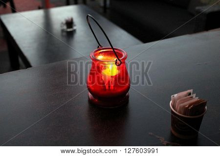 Scented candle stands on a table in a restaurant