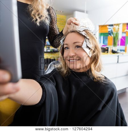 Happy Woman Talking Selfie In Beauty Salon