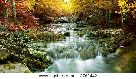 The beautiful waterfall in forest, autumn, long exposure