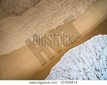Hvar written on the beach
