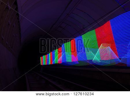 Multi-colored LED light used to create a pattern in a dark tunnel