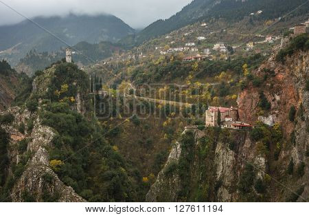 Scenic Mountain Autumn Landscape With A Monastery