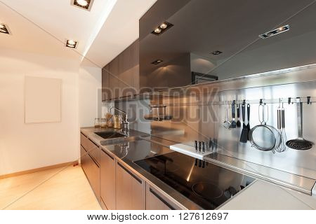 Interiors of new apartment, contemporary domestic kitchen