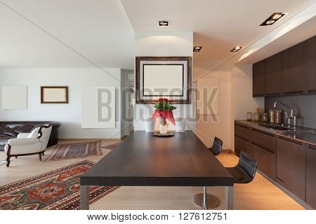 Interiors of new apartment, table of the modern domestic kitchen
