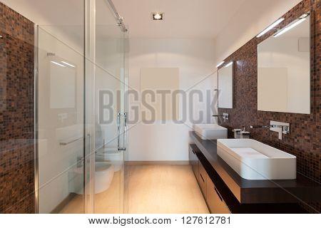 Interiors of new apartment, bathroom, tiled walls
