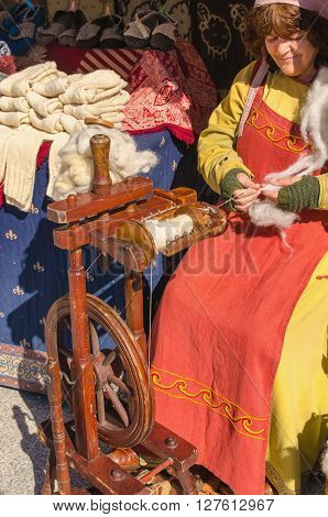 Woman Working On Old Spinning Wheel In Arroyomolinos